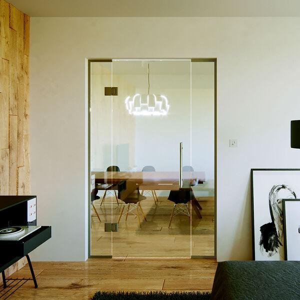 Glazen pendeldeur met zijlicht